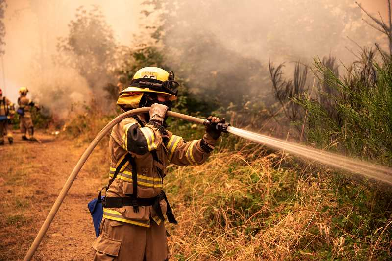 COURTESY PHOTO: TVF&R - Firefighters work to put out one of the many Oregon wildfires responsible for burning more than 4,000 homes this past fall.
