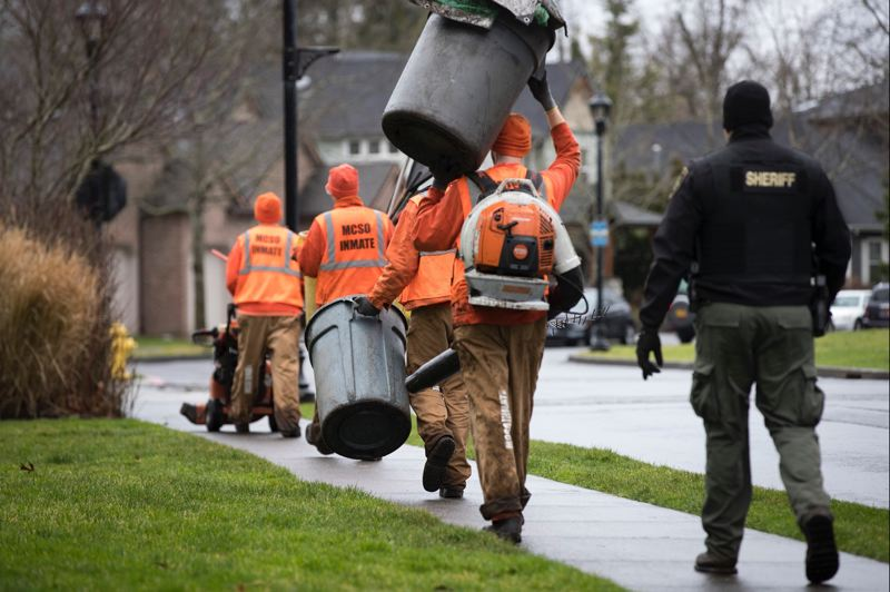 PMG PHOTO: JAIME VALDEZ - Inmate work crews based in Inverness Jail in Northeast Portland clean up homeless camps, illegal dumps and trash on the sides of state highways.
