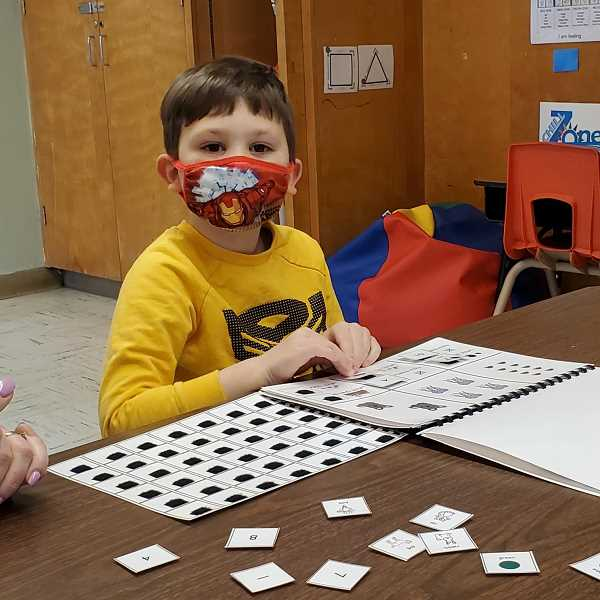 SUBMITTED PHOTO: GRANT WATTS ELEMENTARY - A youngster at Grant Watts Elementary School in Scappoose is masked and ready to go on opening day of school.