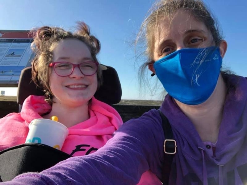 COURTESY PHOTO: COMMUNITY ACCESS SERVICES - The Impact Oregon job board now carries job listings for direct support professionals for people with disabilities. Here a DSP staff (blue mask) is supporting client in Clatskanie on an outing.