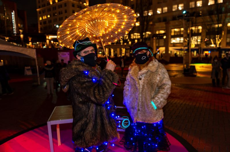 PMG PHOTO: DIEGO G. DIAZ - Attendees Kate and David love the Portland Winter Light Festival, Kate says. 'it's great to have this festival right after the holiday lights have gone out.' They are checking out the light instalation at Pionoer Courthouse Square.