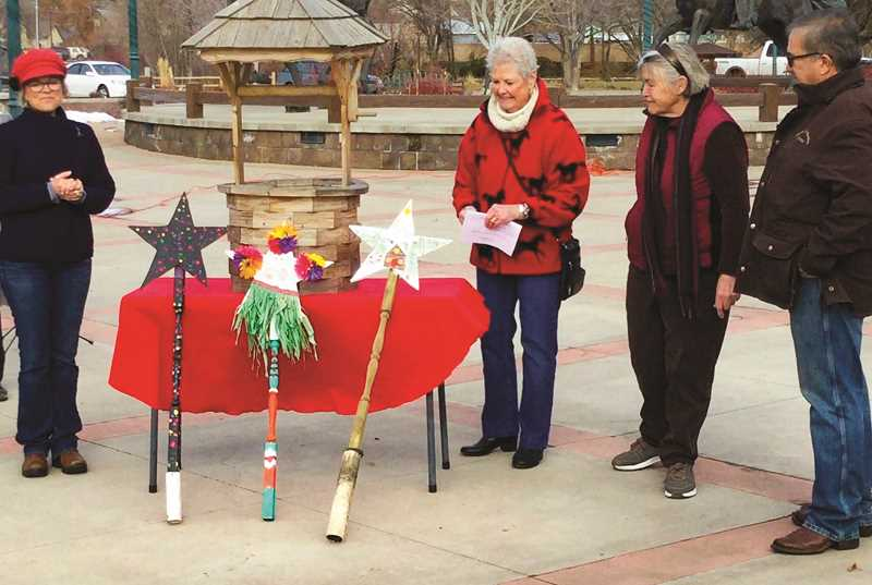 """PHOTO SUBMITTED BY JEANNE ZERBE  - From left: Vikki Breese, Hedda King, Jeanne Zerbe and Steve Forrester. Taken immediately after the drawing for the Wish Sticks tickets on Jan. 30. The group stands in front of the """"wishing well"""" and some of the wish sticks that were displayed during the event leading up to the drawing."""