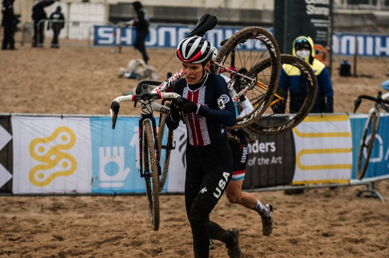 COURTESY PHOTO: TWILA MUZZI/@TWILCHA - Portland resident Clara Honsinger carries her bike through sand on Jan. 30 on her way to a fourth-place finish at the UCI Cyclo-cross World Championships in Ostend, Belgium.