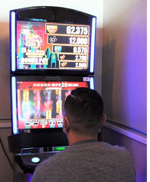 PAT KRUIS/MADRAS PIONEER  - Oregon Lottery reopened video lottery games Jan. 27, with some restrictions: no more than six players at a time, players must stay 6 feet apart, and no food or drink may be served indoors.