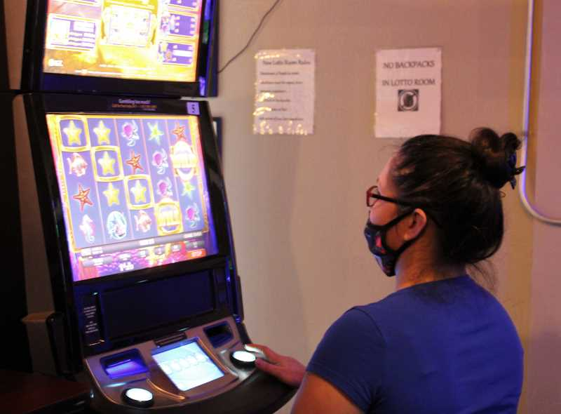 PAT KRUIS/MADRAS PIONEER  - The return of Oregon lottery video game action has many wondering why bars and restaurants can't fully open.