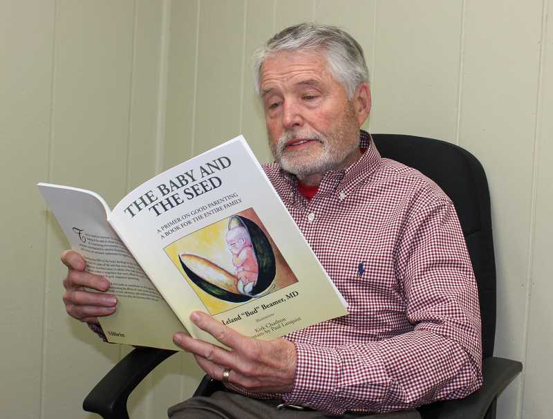 """HOLLY SCHOLZ/MADRAS PIONEER   - Dr. Bud Beamer hopes his new book """"The Baby and the Seed"""" educates parents on the importance of a nurturing and loving home environment."""