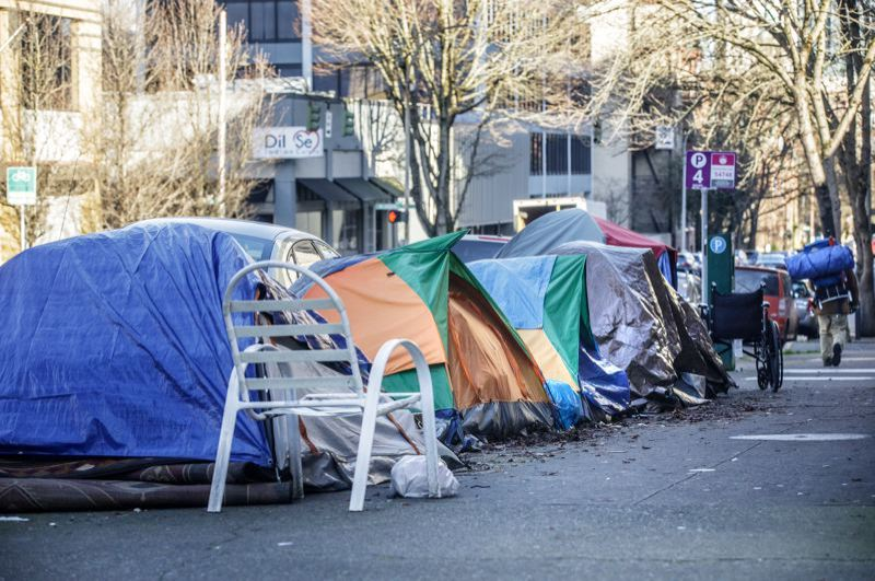 PMG PHOTO: JONATHAN HOUSE - Visible outdoor camping like these downtown tents has increased significantly during the COVID-19 pandemic