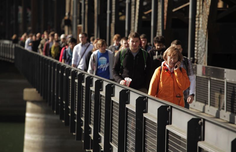 PMG FILE PHOTO - Portland author Sharon Wood Wortman, in front, leads a tour of dowtnown bridges. Wood Wortman argues that Portland is not in decline and needs some help from people who love the city.