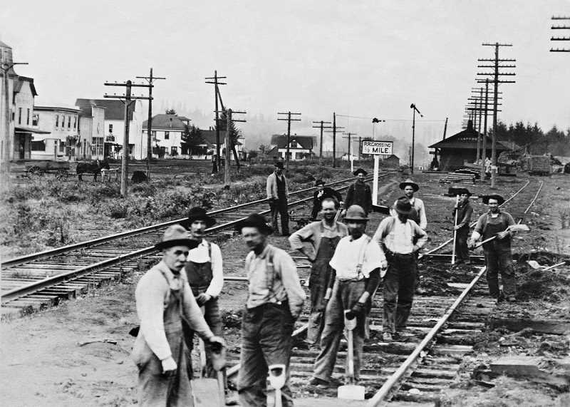 COURTESY PHOTO: SCAPPOOSE HISTORICAL SOCIETY - Men work on the train tracks in the Scappoose business district in 1920, the year before the city was incorporated.