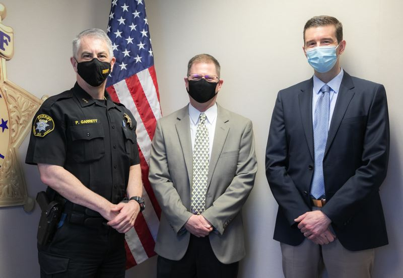 COURTESY PHOTO: WASHINGTON COUNTY DISTRICT ATTORNEY'S OFFICE - Left to right, Washington County Sheriff Pat Garrett, Detective Kevin Winfield and Washington County District Attorney Kevin Barton at a swearing-in ceremony for Winfield as the county's new cold case detective.