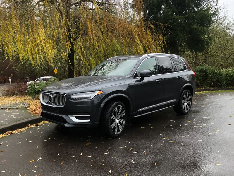 PMG PHOTO: JEFF ZURSCHMEIDE - Volvo now offers its largest luxury SUV, the mid-size, seven-passenger XC90, with a plug-in hybrid drivetrain that combines the best of green and luxury driving.