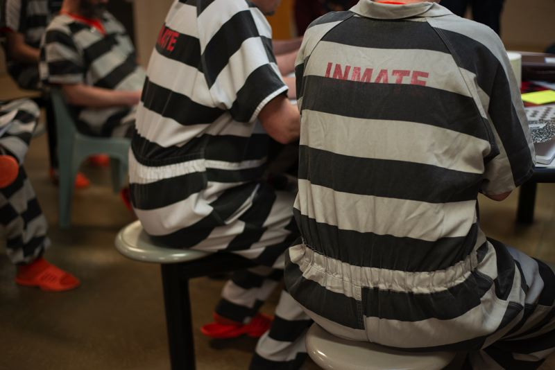 FILE - Inmates congregate inside an Oregon facility in Columbia County in 2018.