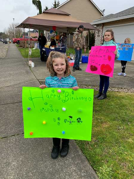 COURTESY PHOTO: DANIELLE COREY - Fred Quintero's grandchildren hold signs that read, 'Happy Birthday Papa' and 'I heart you.'