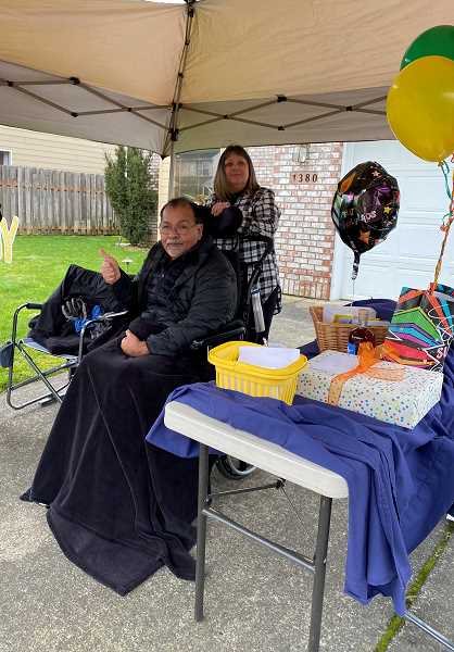 COURTESY PHOTO: DANIELLE COREY - Fred Quintero enjoys his birthday parade Feb. 6 from the comfort of a covered tent.