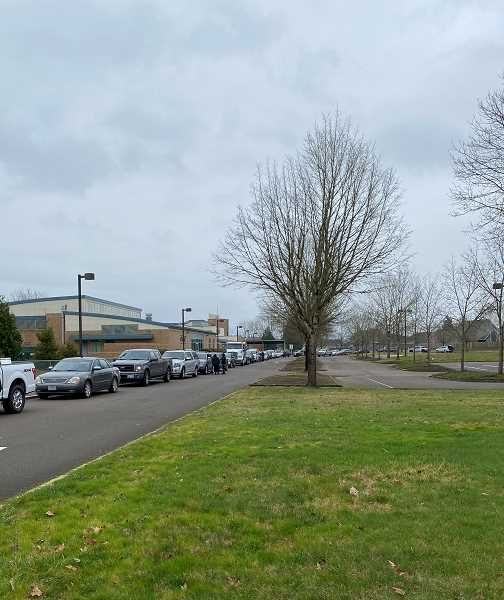 COURTESY PHOTO: DANIELLE COREY - Cars and cars lined up to stage for the parade at Trost Elementary School.