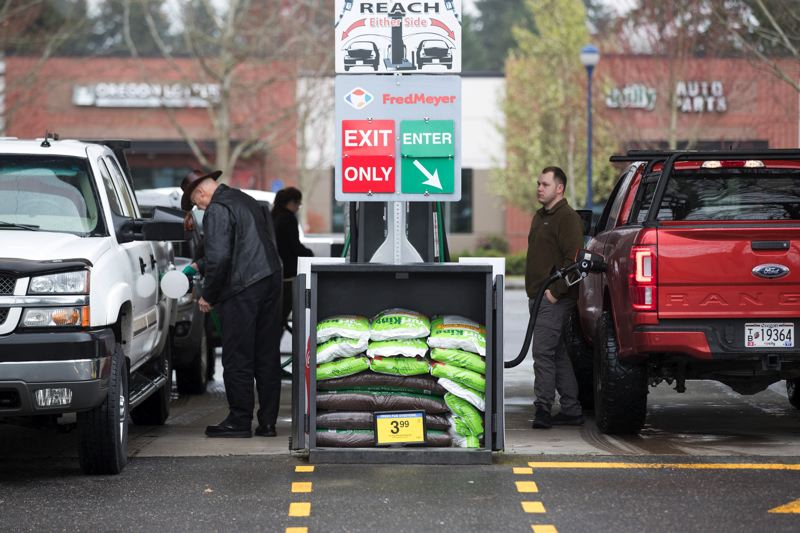 PMG PHOTO: JAIME VALDEZ - Motorists fill up their own tanks at a Fred Meyer gas station in Wilsonville on Monday, March 30, 2020, when Oregon's ban on self-serve gas was lifted temporarily due to the pandemic.
