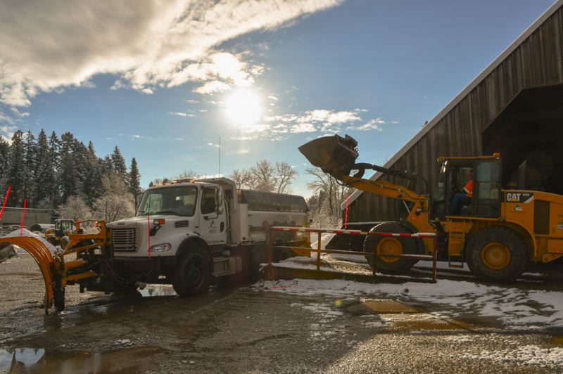 PHOTO COURTESY OF CLACKAMAS COUNTY - Clackamas Couny road maintenance crews load up to prepare for winter weather ahead of the first and potentially last snow storm of the 2020-21 winter season.