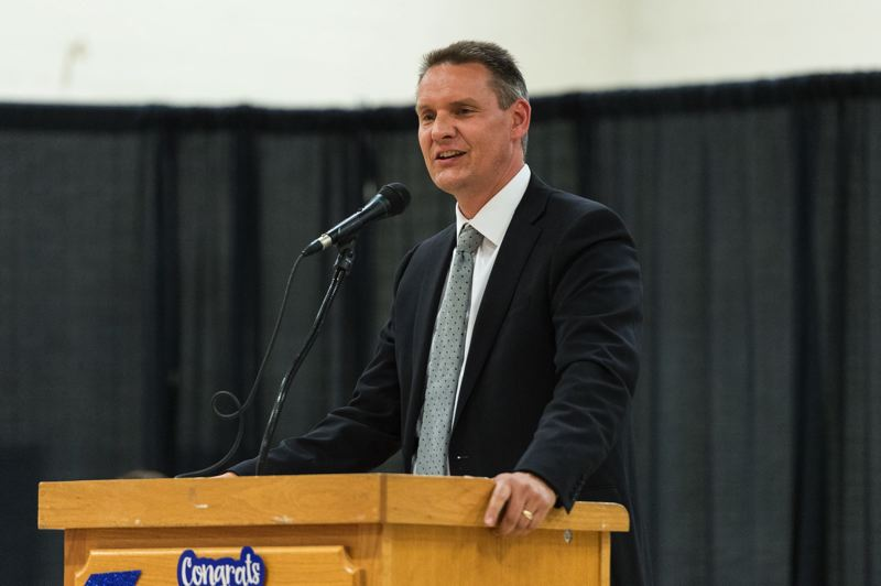 PMG FILE PHOTO - Hillsboro School District Superintendent Mike Scott speaks at a graduation ceremony for the Hillsboro Online Academy in 2017.