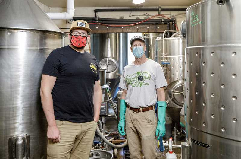 PMG PHOTO: JONATHAN HOUSE - Binary Brewings Josh Johnson, left, and Roger Wood in their current Scholls Ferry Road location.
