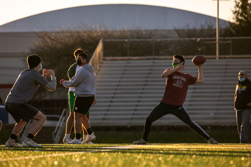 PMG PHOTO: JAIME VALDEZ - Thomas Oh throws a pass during a Feb. 9 football practice at Cleveland High School.