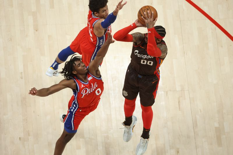 COURTESY PHOTO: BRUCE ELY/TRAIL BLAZERS - Philadelphia defenders had a tough time to stopping Carmelo Anthony, as he scored 17 of his 24 points in the fourth quarter of a 118-114 Portland win Thursday.