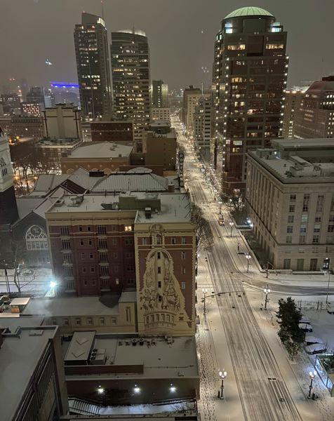 PMG PHOTO: DANA HAYNES - A pre-dawn dusting of snow Friday, Feb. 12, on Southwest Broadway in downtown, is a mild indicator of the predicted snow heading our way.