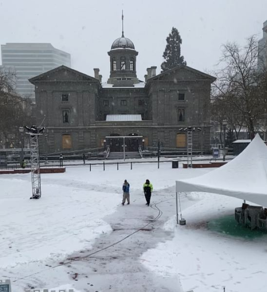 PMG PHOTO: DANA HAYNES - The lovely old Pioneer Courthouse, and the mostly empty square named after it, glistens in snow early Friday, Feb. 12.