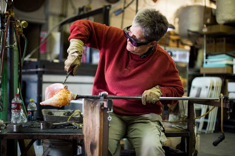 COURTESY PHOTO: CHARLENE FORT - Charlene Fort, shown here working on a glass conch shell, is the Hood River artist who created 150 of the hand-sculpted hearts, found in various colors, which have been distributed throughout the city.