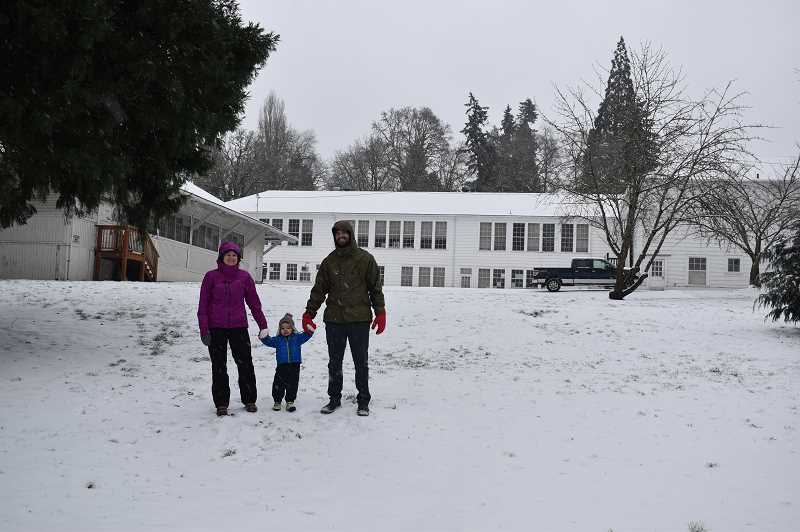 PMG PHOTO: RAYMOND RENDLEMAN - Nick and Katie Ray with their daughter Violet, 2, visit Barclay Park on Feb. 12 to enjoy the newly fallen snow in Oregon City.
