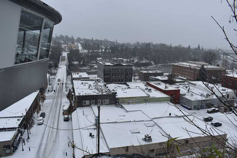 PMG PHOTO: RAYMOND RENDLEMAN - Downtown Oregon City gets covered in snow on Feb. 12.