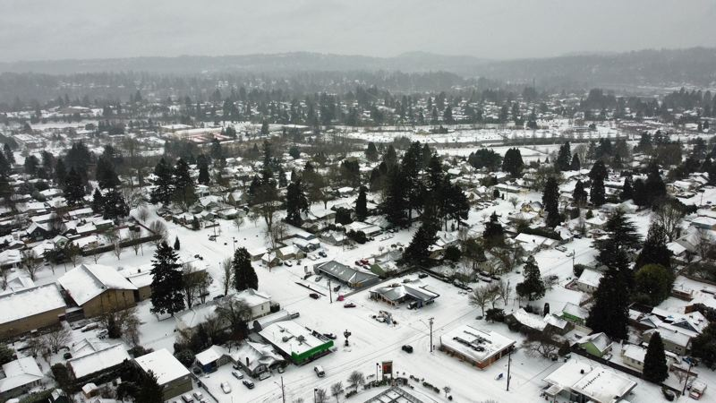 PMG PHOTO: ALVARO FONTAN - A drone over Milwaukie, Friday morning, catches the blanket of snow that arrived overnight.