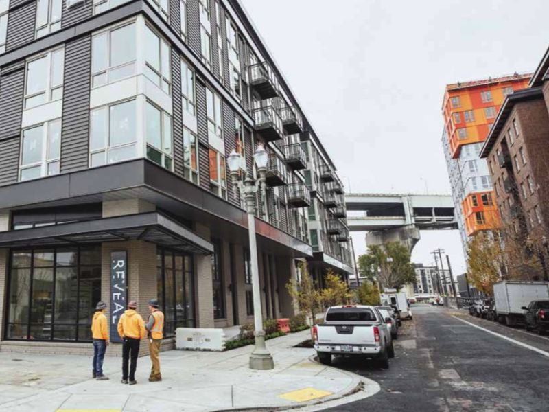 PMG GROUP: JONATHAN HOUSE  - Residential construction such as this project, photographed in 2018 has taken a heavy hit during the pandemic, according to a new report from the Portland Business Alliance. Pictured here a mix of market rate (left) and affordable housing on Northwest 14th Ave.