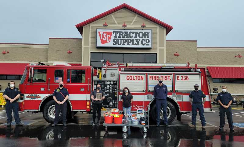 COURTESY PHOTO: COLTON FIRE - First responders from CRFPD No. 70 present an award to Molalla Tractor Supply Company. Pictured from left are Brad Kuhn, Chris Cohoon, Justine Walker, Endora Mitchell, Tom Judd, Mike Decristoforo and Matt Rodriguez.