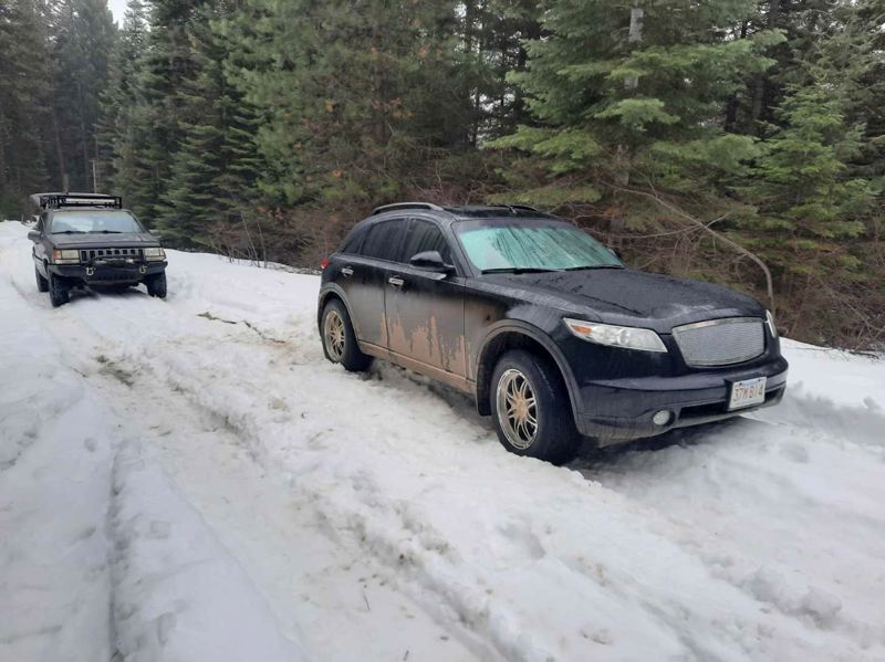 Photo provided by Marc, on the right, the Xfinity SUV stranded in the snow, on the left, Marc's Jeep during the recovery.