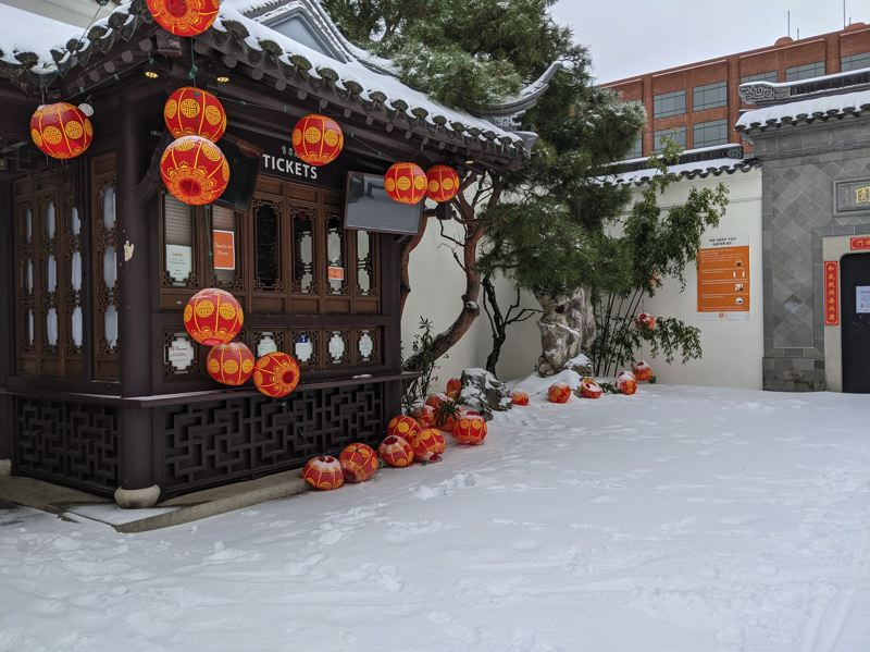 PMG PHOTO: JOSEPH GALLIVAN - Snow covered the ticket booth at the Chinese Garden in downtown Portland on Saturday, Feb. 13.