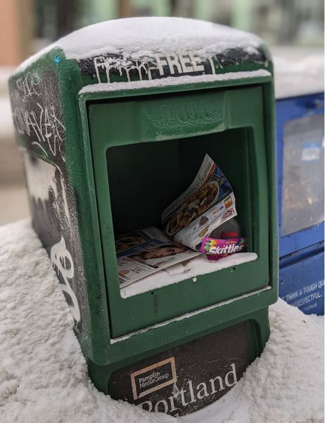 PMG PHOTO: JOESPH GALLIVAN - A snowy Portland Tribune newspaper box in downtown Portland on Feb. 13 is shown here.