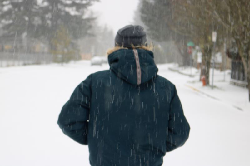 PMG PHOTO: ZANE SPARLING - A man trudges through the snow on Friday, Feb. 12.