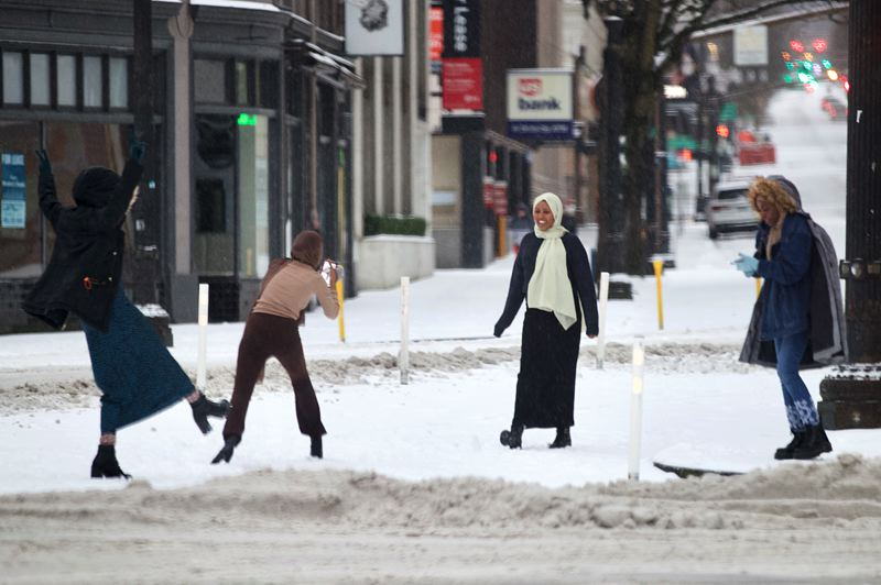 PMG PHOTO: JAIME VALDEZ - A woman takes part in a photo shoot along SW Broadway in downtown Portland on Friday, Feb. 12.