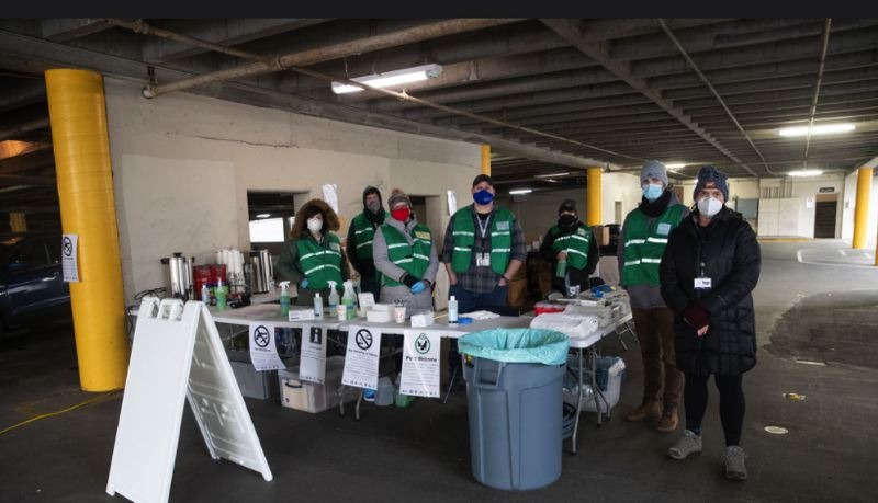 COURTESY PHOTO: JOHS - Staff prepare to welcome people at the Metro Garage shelter.