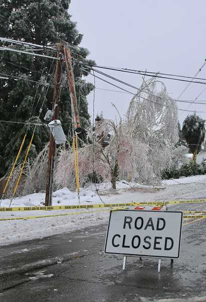 PMG PHOTO: J. BRIAN MONIHAN - Sunset Avenue was closed as downed wires lined the street.