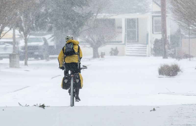 PMG PHOTO: JONATHAN HOUSE - A cyclist took the snowy streets in SE Portland.