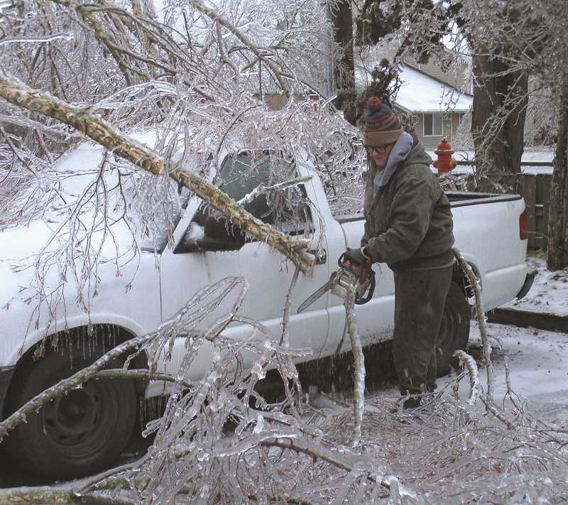 PMG PHOTO: DEBORAH GUINTHER - Folks in Canby and Molalla were out late Saturday and early Sunday with chainsaws as they assessed the damage and tried to free up their vehicles.