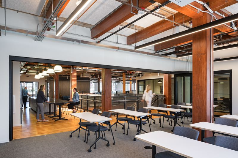 COURTESY PHOTO: SKANSKA USA - A meeting room with accordion doors which can be opened up for large groups of subcontractors at Skanska USA Construction's new space in the Pearl.