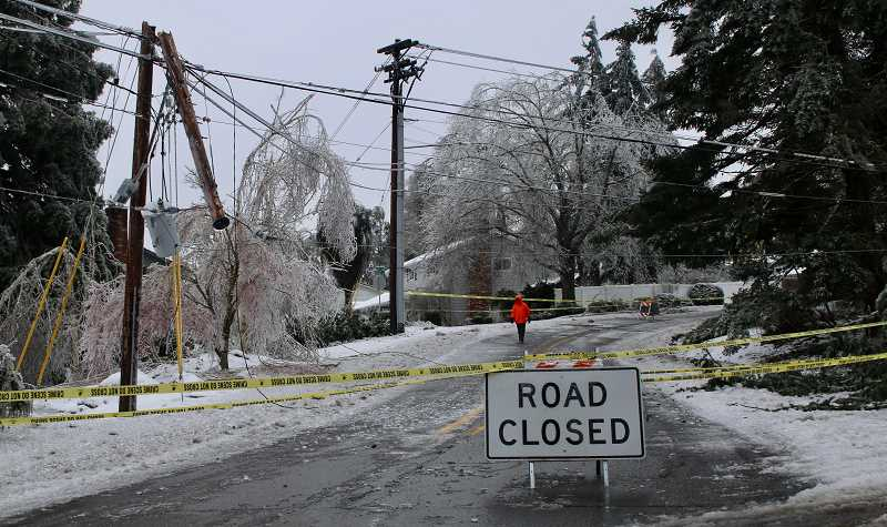 PMG PHOTO: BRIAN MONIHAN - Sunset Avenue is closed off due to ice, downed trees and powerlines.