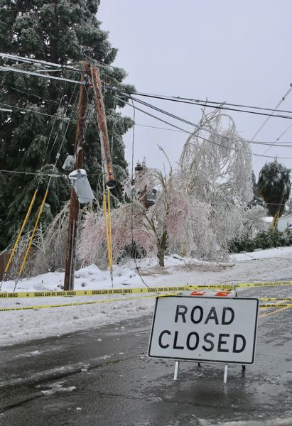 PMG PHOTO: J. BRIAN MONIHAN - Sunset Avenue in West Linn was closed as downed wires lined the street.