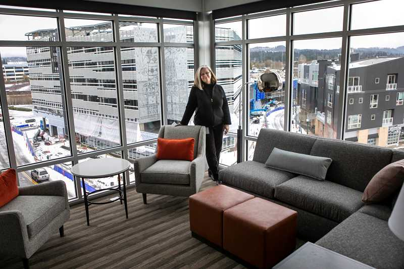 PMG PHOTO: JAIME VALDEZ - Monica Cheeks, Hyatt House manager, strand in the corner in one of the premiere one bedroom suite on the fifth floor of the new hotel in Beaverton.