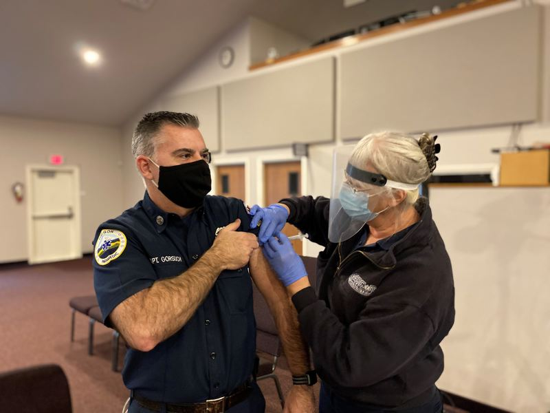 COURTESY PHOTO: COLUMBIA RIVER FIRE & RESCUE - Columbia River Fire & Rescue Capt. Michael Gorsuch receives a COVID-19 vaccination in January.