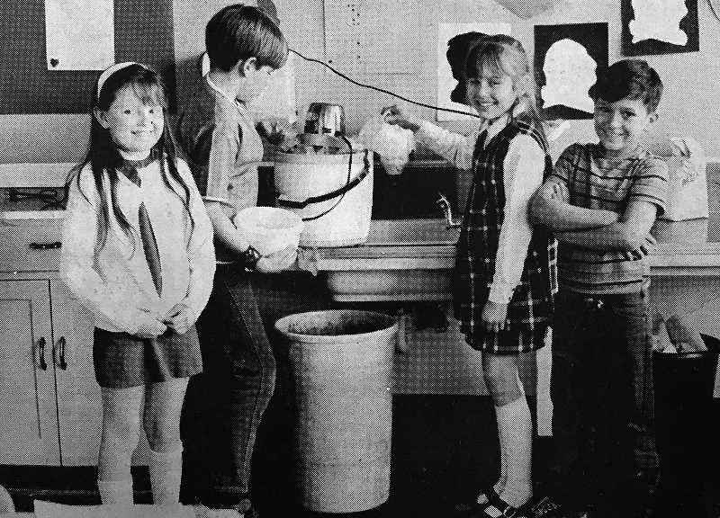 CENTRAL OREGONIAN - February 18, 1971: Rooms 9 and 21 at Ochoco School, taught by Mrs. Art Smith and Gerald Morsello, added their own original touches to the Valentine's Day festivities at the school by making their own homemade ice cream. Becky Puckett, Neil Lidstrom, Debra Pinkston and Jim Smith of Room 9 show how easy it is as they anticipate the pleasures in store at the party.