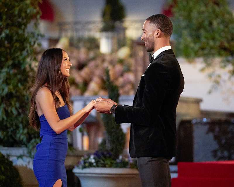 COURTESY PHOTO: ABC/THE BACHELOR - Abigail Heringer holds hands with bachelor Matt James on the first night of ABCs The Bachelor. Heringer is now eliminated from the show.