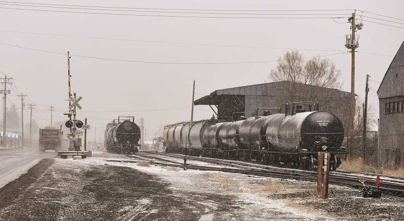 RAMONA MCCALLISTER - The railcars from McCall Oil on Lamonta Road provide a backdrop for the blustery weather Friday afternoon. It is an asphalt transfer station — and operates seasonally from March 15 to Nov. 1. Asphalt oil is brought in from Canada, Montana and Texas and it is offloaded for transfer on COPR property.